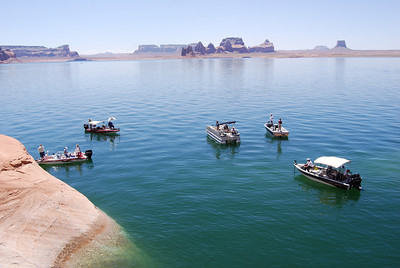 Anglers surround a school of stripers on the rock ledge in Padre Bay. Over 300 stripers were caught on bait in one morning at a gorgeous setting in Lake Powell. May 19, 2008. Photo by Wayne Gustaveson, DWR