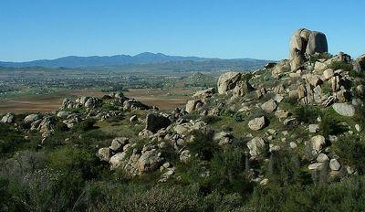 Lakeview Mountains, looking toward Saddleback (Santiago & Modjeska Peaks), 19 Dec 2004.  Fish Rock on the right. Romoland & Sun City in midground.