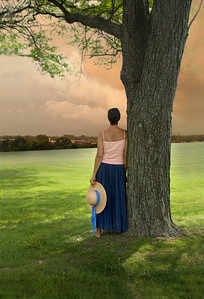 a lone woman looking out on landscape, a lone woman looking out on landscape
