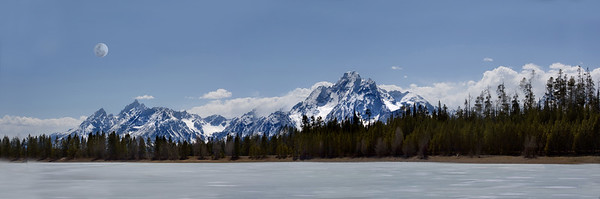 a scene of theTetons, the moon, and a lake in Wyoming
