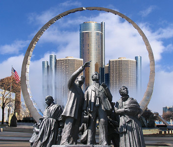 A montage of Detroit landmarks from a riverside park