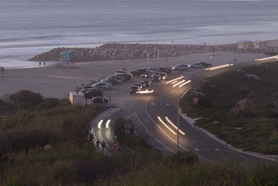 Highway 101 passing Ponto State Beach and jetty, busy post sunset. Carlsbad 2-12-2015