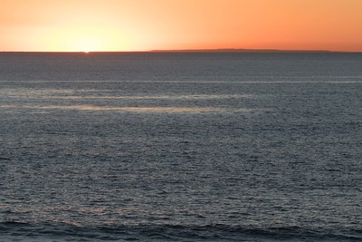 Sun setting with San Clemente island visible off the shore of Leucadia, CA