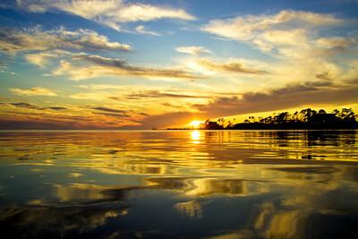 mirror image sunset at the Gulf Breeze bridge