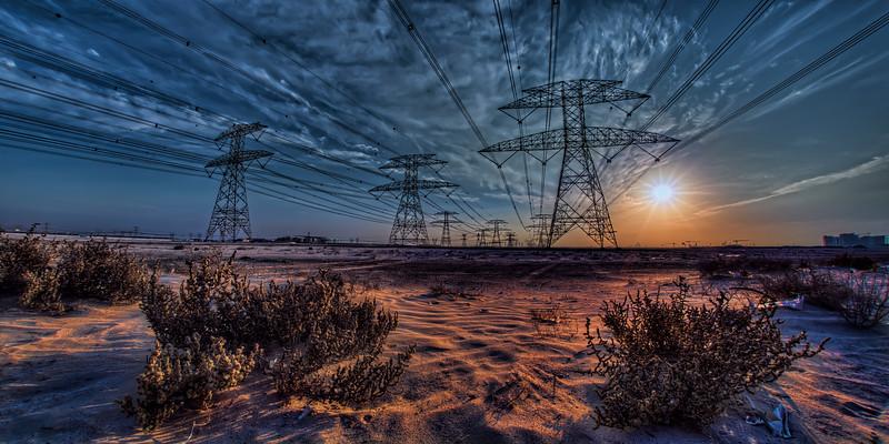 UEA Duabi powerlines in the desert at sundown