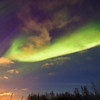 Over the skies of Kiruna, light from the aurora mingles between the border of city and natural sky light.