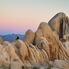 Enjoying sunset along a large inselberg in Joshua Tree. <br /> These strange rock formations were formed by cooling magma beneath the surface, which was later eroded by ground water when the park was much wetter. Then climates changed, turning Joshua Tree into an arid desert and flash floods pulled away the loose soil to reveal the astounding rock formations which make this park would famous.
