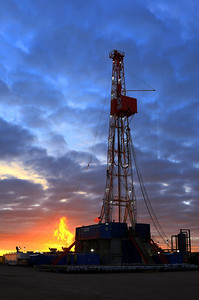 Patterson Rig 166 drilling near Potter Nebraska. The morning sunrise turns the steam to fire.