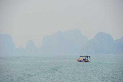 Lone boat, Bai Tu Long Bay, Vietnam