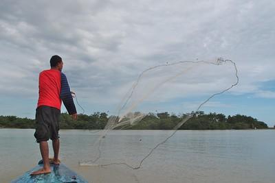 Fisherman casting net, Kampong Pulau Suri, Kelantan, Malaysia