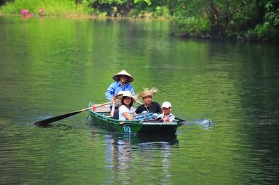 Devotees, Trang An lakes, Vietnam