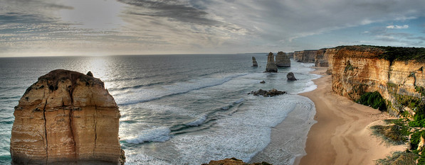 <font color = #333fff> Panoramic view of the Twelve Apostles. The rubble near the beach on the right was another apostle that collapsed in 2005. As of now, I can locate 7 of them. </font>