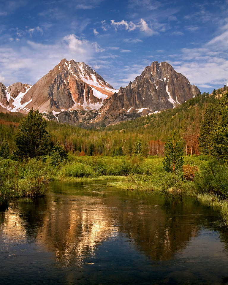 Castle and Merriam Peaks in the Boulder White Clouds Idaho, proposed wilderness. Reflected in a beaver pond. Photo by Mike Reid, All Outdoor Photography.