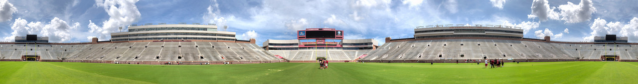 Florida State University Stadium in Tallahassee Florida.  This is a panorama that covers a little more than 360 degrees around the stadium.  Notice that the scoreboard on the south end is on each end of the panorama.   This panorama image is composed of ten images, each of which is a three image HDR photo.  So it took 30 photos to put this pan image together.