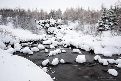 Snowy stream at Kalda Lyngholt, Iceland