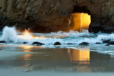 Pfeiffer Beach  In late December I was hoping to catch both the reflection on the beach and the lit up splash to the left, when I noticed the streamers of water in the doorway arch that were present (and lit up) for three or four seconds after a large wave would inundate the arch with water.   I was fortunate to catch those three elements in this photo.