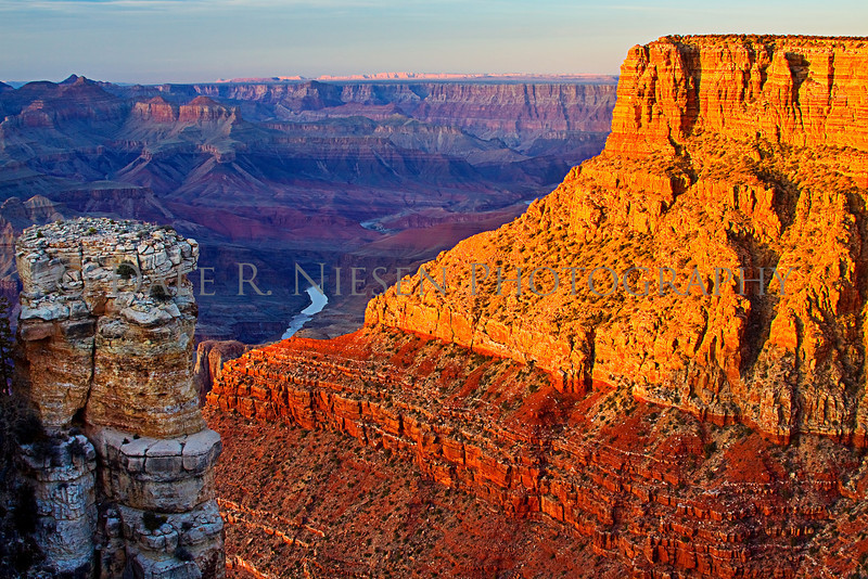 The reflection of sunset on the cliffs at Moran Point, Grand Canyon National Park, Arizona