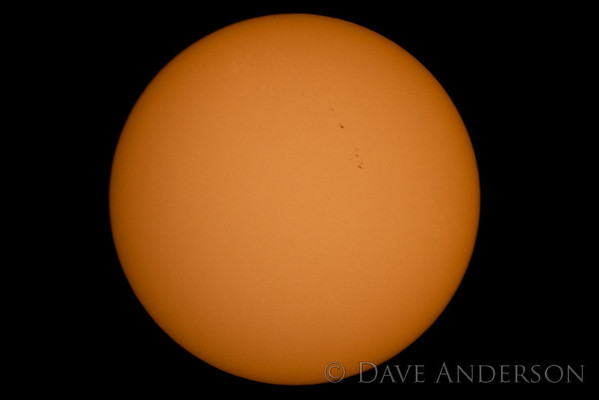 Sun Photographed with Orion XT8 Dobsonian reflector telescope at prime focus(1200mm f/5.9) - Cropped to about 50% size. Solar filter is polished glass triple-coated with nickel-chromium stainless steel and covers whole primary aperture of telescope. This coating blocks 99.999% of the light -- approx. equivalent to a ~16.5-stop ND filter.