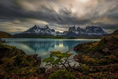 A long exposure early afternoon rendered cloud streaks over Cuernos Principal and Cerro Paine Grande