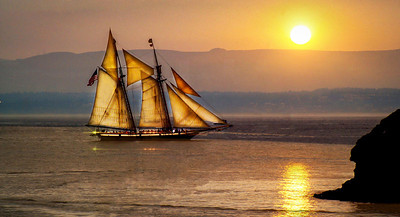 Sailing at sunset.  Three photo composite.
