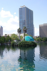 Palm Trees and Lake Eola Ampitheater in Downtown Orlando, Florida.
