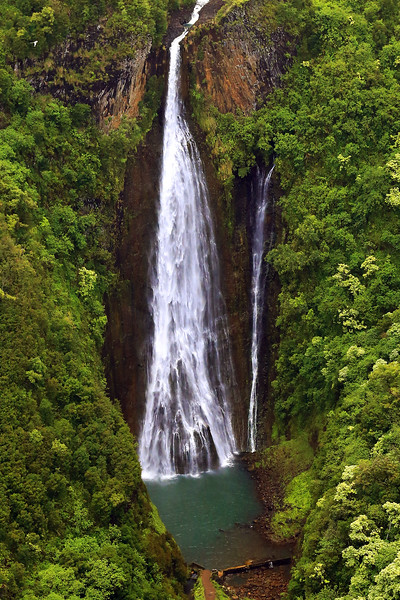 "Manawaiopuna Falls - Kauai - Hawaii :  This beautiful, 400 foot waterfall used to be a secret... then it was used in the famous helicopter landing scene in the 1993 movie, ""Jurassic Park"".   Now it is, often, referred to as ""Jurassic Falls""."