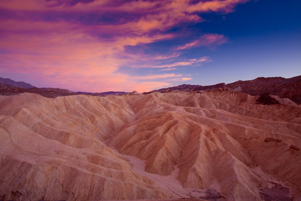 Zabriskie Point / Death Vallet National Park / California  Sunset at Zebriskie point in Death Valley. The sunset colors reflected from the rocks