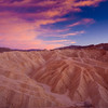 Zabriskie Point / Death Vallet National Park / California<br /> <br /> Sunset at Zebriskie point in Death Valley. The sunset colors reflected from the rocks