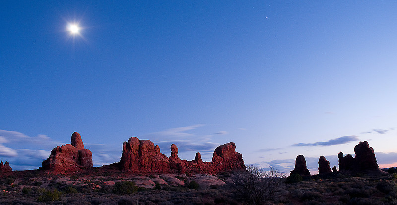 The moon ads to the beauty of the evening sky in Arches.