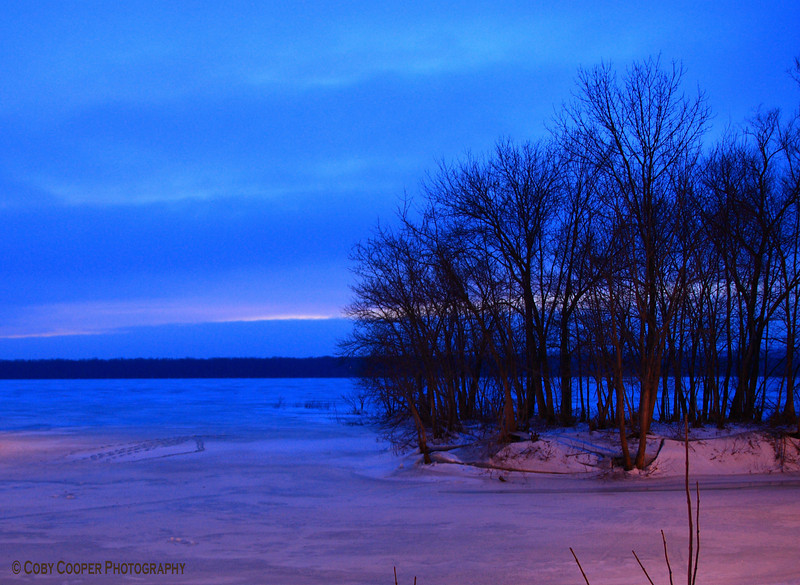 January 17, Shot Saturday evening as dark overtook the frozen Illinois River. This is a timed exposure. It was eerie taking this shot as the river groans, creeks and pops as the ice expands