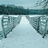 Burke Lake fishing pier covered in snow over the frozen lake
