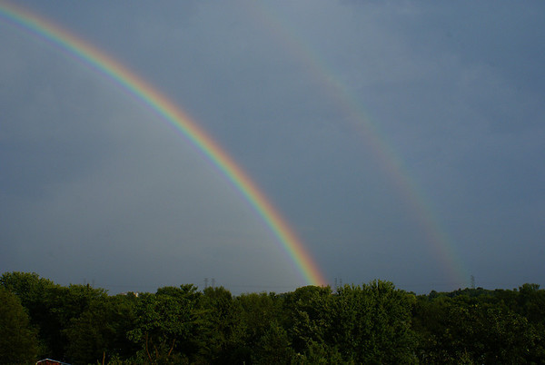 After a summer storm, a double rainbow forms over Ottawa.  This was taken from my balcony, facing south towards the Ottawa International Airport.  Photo taken 4 August 2010.