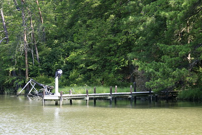 OK, so here's the same spot on Meyer's Creek, taken 5 years later. Since then Hurricane Isabelle passed thru, and the dock has been rebuilt.  Also, I took this with my Canon 5D 12.8 Megapixel camera using a 28-300MM L series lens with optical stabilization. I like the shot taken with My old Sony 3 mp better. What do you think?