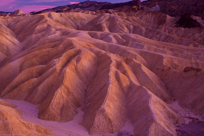 Zabriskie Point / Death Vallet National Park / California  Sunset at Zebriskie point in Death Valley. The sunset colors got accentuated on the rock walls. The colors were enhanced using a circular polarizer. It was one of the most beautiful sunsets I have seen