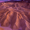 Zabriskie Point / Death Vallet National Park / California<br /> <br /> Sunset at Zebriskie point in Death Valley. The sunset colors got accentuated on the rock walls. The colors were enhanced using a circular polarizer. It was one of the most beautiful sunsets I have seen