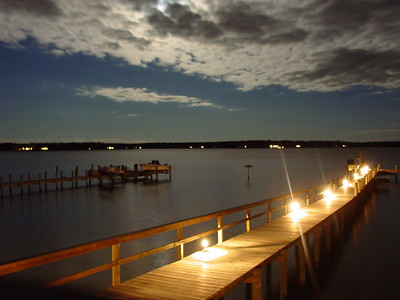 Moonlight over the Corrotoman River, Northern Neck, Va. The dock on the right is the replacement for the one destroyed by Isabelle in 03'