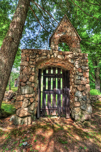 Lynne and I were back in lovely New Hampshire a few weekends ago, and while driving around, I spotted this magnificent gate. It was part of a residential house, and was very odd given the neighborhood it was in (there was a nice horse farm right up the road, which I'll be showing shots from soon, I hope). Anyway, my real estate work has made me more brazen in my pursuit of the perfect shot. There were some undesirable objects in the way, and rather than photoshop them out later, I moved them. Low tech, but very effective! There was some front lawn trespassing after this shot, but nothing invasive. Such a cool looking house too. If any of those turn out, they'll get posted too.  I really liked the varying light and shadows cast by the trees, and the light coming through the door. It kind of reminds me of something from True Blood, specifically Sookie's coma/dream land.  EF-S 10-22mm f/3.5-4.5 USM @ 10mm ISO 200, f/11 at 1/15, 1/60, and 1/4 second