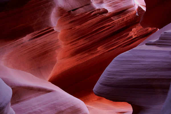 Lower Antelope Canyon / Novajo / Page / Arizona  This was taken in the Lower Antelop Canyon in Page, Arizona. The lower antelope canyon is an underground canyon. The rocks that build the side walls get different colors depending on the position of the sun in the sky. Did not get much time in there to photograph, but a totally amazing place to see and photograph. Would recommend a visit to this place. This is less commercialized than the Upper Antelop Canyon and you can spend time at your leisure here unlike the Upper Canyon. This was the best I could get in the short time I spent there.