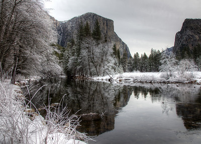 El Capitan rises above Yosemite Valley and the Merced River