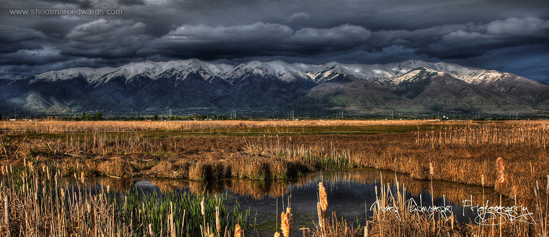 Shot taken in Layton at the end of the winter, I am standing on a boardwalk at the Layton Bird Refuge, 3200 W and Gordon ave. The storm was rolling out to the east, and the sun was coming through the clouds in the west, behind me.