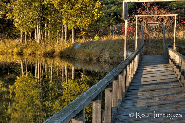 Bridge across the mill pond dam, Waba River, White Lake area, Ontario. HDR I feel fortunate to have access to this beautiful area. It is private property of a friend of a friend. © Rob Huntley