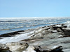 Welcome to the sun and fun on the beach of Point Barrow, Alaska the most northern point of North America.  You are looking out over the Artic Ocean during mid June.