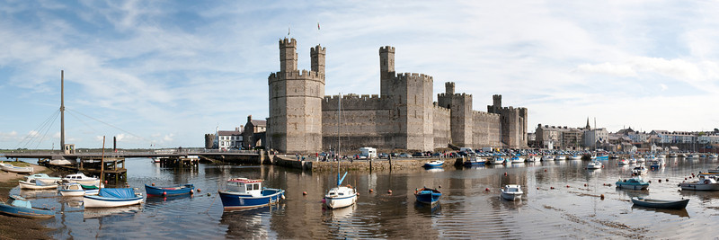 Panoramic view of Caenarfon Castle from across the harbor