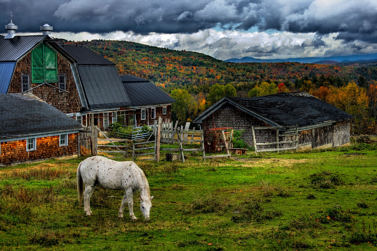 This photograph was taken in Bethlehem, New Hampshire. It is one of my earliest HDRs that I was thrilled with, and still stands as one of my favorite photographs.  There's also a fantastic pancake house right up the road where everything made is grown on this farm.