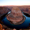 HorseShoe Bend / Page / Arizona<br /> <br /> This was taken on a very chilly morning at the horseshoe bend in Arizona. I went out there in a thin jacket with all my gear but no gloves. I thought that it will get hot when the sun rises and so it wouldn't matter. I was so wrong :(. It might have been getting hotter when the sun rose, but for me, specially for my fingers, it was getting colder and colder. The sky did not do anything dramatic, but the mountains in the distance were lit bright red due to the early sun. Got a few shots before making my fingers completely cold, numb and useless. Took a long time after reaching back to the hotel to regain sensation in my fingers. But overall, I could capture the place during sunrise and it was a good lesson learnt.