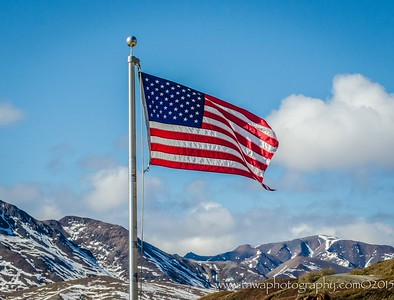 American Flag Waving Over Denali National Park Eielson Visitor Center Denali National Park, Alaska © 2015  TNWA Photography / Debbie Tubridy