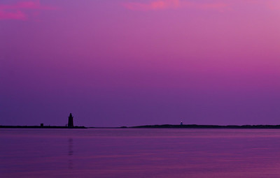 Purple lighthouses.  Sunrise over Delaware Bay.  Lewes DE.