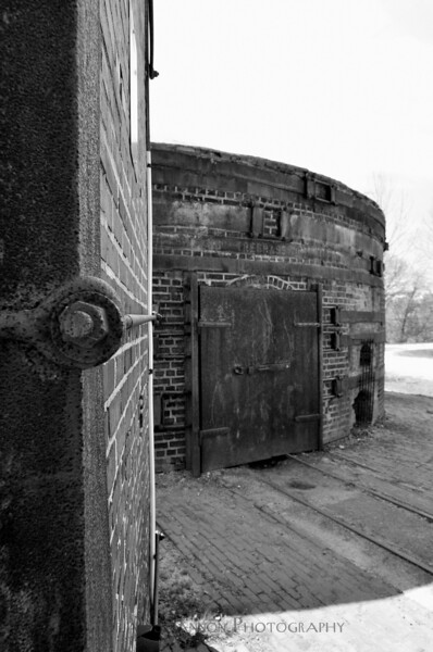 Brick oven door and chimney in black and white