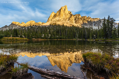 El Capitan reflecting in the outflow of Alice Lake in the Sawtooth Mountains during a September evening in Idaho.