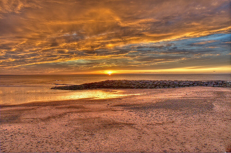 Sunset over Tywyn beach